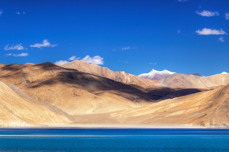 ridge of wave: Mountains and Pangong tso Lake. It is huge lake in Ladakh, altitude 4,350 m 14,270 ft. It is 134 km 83 mi long and extends from India to Tibet. Leh, Ladakh, Jammu and Kashmir, India