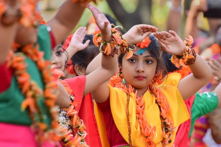 bengali: KOLKATA , INDIA - MARCH 5, 2015 : Girl child dancers performing at Holi  Spring festival, known as Dol in Bengali or Holi in Hindi celebrating arrival of Spring in India. A very popular festival amongst Bengalis.