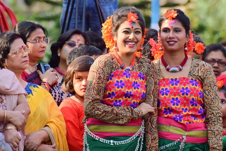 bengali: KOLKATA , INDIA - MARCH 5, 2015 : Young girl dancers joyful expression at Holi  Spring festival, known as Dol in Bengali or Holi in Hindi celebrating arrival of Spring in India. A very popular festival amongst Bengalis. Editorial