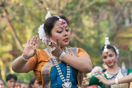 bengali: KOLKATA , INDIA - MARCH 5, 2015 : Yound girl dancers performing at Holi  Spring festival, known as Dol in Bengali or Holi in Hindi celebrating arrival of Spring in India. A very popular festival amongst Bengalis. Editorial