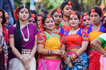 bengali: KOLKATA , INDIA - MARCH 5, 2015 : Young girl dancers waiting to perform at Holi  Spring festival, known as Dol in Bengali or Holi in Hindi celebrating arrival of Spring in India. A very popular festival amongst Bengalis.
