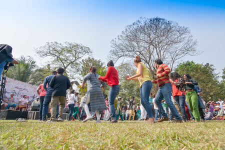 sutra: KOLKATA , INDIA - FEBRUARY 8, 2015 : Young crowd from different cultures across the world, are dancing in Sufi Sutra International Dance festival on field. It is a popular annual dance program in Kolkata.