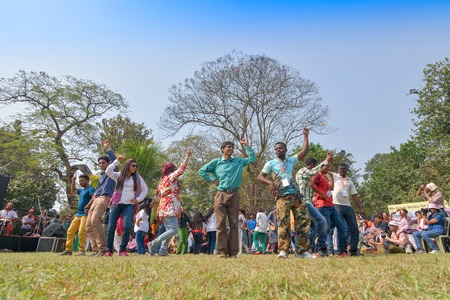sufi: KOLKATA , INDIA - FEBRUARY 8, 2015 : Young crowd from different cultures across the world, are dancing in Sufi Sutra International Dance festival on field. It is a popular annual dance program in Kolkata.