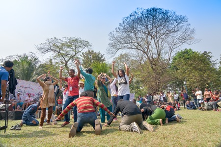 sutra: KOLKATA , INDIA - FEBRUARY 8, 2015 : Young crowd from different cultures across the world, are dancing in Sufi Sutra International Dance festival on field. It is a popular annual dance progarm in Kolkata.