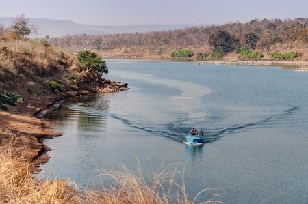 madhya: Boating at beautiful Panna river at Panna National Park, Madhya Pradesh, India. It is located in Panna and Chhatarpur districts of Madhya Pradesh in India. It has an area of 542.67 km2, a tiger reserve. Stock Photo