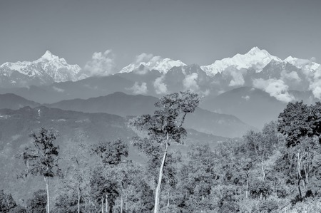 Beautiful view of Silerygaon Village with Kanchenjunga mountain range at the background, moring light, at Sikkim, India. Black and white stock image. Stock Photo