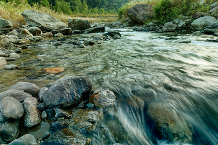 Beautiful Reshi River water flowing on rocks at dawn, Sikkim, India - a spectacular view , tinted image