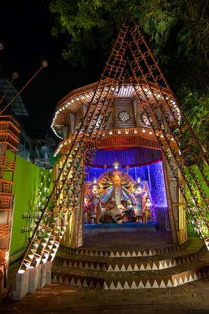 devotee: KOLKATA , INDIA - OCTOBER 18, 2015 : Night image of decorated Durga Puja pandal, shot at colored light, at Kolkata, West Bengal, India. Durga Puja is biggest religious festival of Hinduism. Editorial