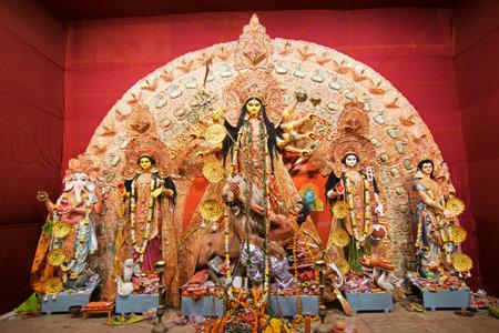 KOLKATA , INDIA - OCTOBER 18, 2015 : Night image of decorated Durga Puja pandal, shot at colored light, at Kolkata, West Bengal, India. Durga Puja is biggest religious festival of Hinduism. Editorial