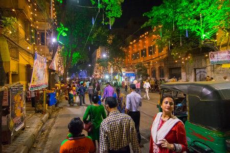 puja: KOLKATA , INDIA - OCTOBER 18, 2015 : Night image of decorated street of Kolkata, shot at colored light, during Durga Puja festival, West Bengal, India. Durga Puja is biggest religious festival of Hinduism. Editorial