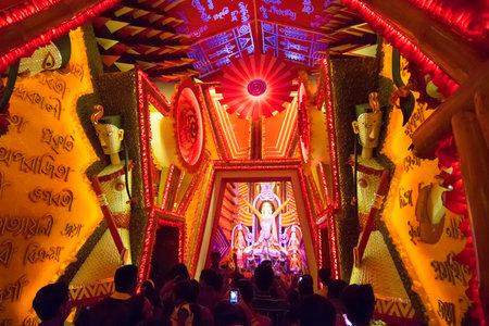 puja: KOLKATA , INDIA - OCTOBER 18, 2015 : Night image of decorated Durga Puja pandal, shot at colored light, at Kolkata, West Bengal, India. Durga Puja is biggest religious festival of Hinduism. Editorial