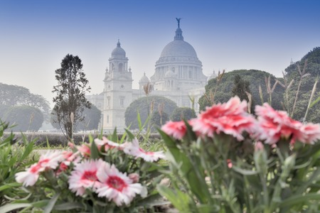 Flowers and Victoria Memorial, Kolkata , India . A Historical Monument of Indian Architecture. It was built between 1906 and 1921 to commemorate Queen Victoria's 25 years reign in India.