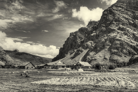 Sceneic view of Drass village with blue cloudy sky background , Kargil, Ladakh, Jammu and Kashmir, India, Nice Sepia toned image depicting beautiful rural hilly Indian view