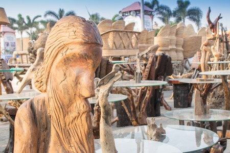 Wooden sculpture, face of world famous poet Rabindranath Tagore, tables with glass on top, handicrafts on display during the Handicraft Fair in Kolkata , earlier Calcutta, West Bengal, India. Stock Photo
