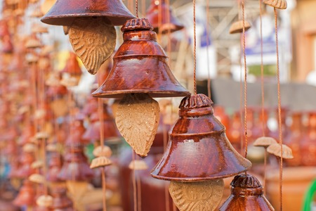 Designer bells made of clay, handicrafts on display during the Handicraft Fair in Kolkata , earlier Calcutta, West Bengal, India. It is the biggest handicrafts fair in Asia.