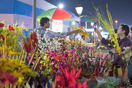 Kolkata, West Bengal, India - 28th November, 2015 : Selling and buying of artificial flowers made out of colored plastics, handicrafts on display during the Handicraft Fair in Kolkata. Biggest handicrafts fair in Asia. Editorial