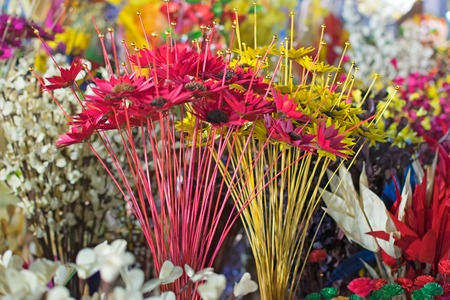 Artificial flowers made out of colored plastics, handicrafts on display during the Handicraft Fair in Kolkata , earlier Calcutta, West Bengal, India. It is the biggest handicrafts fair in Asia. Stock Photo