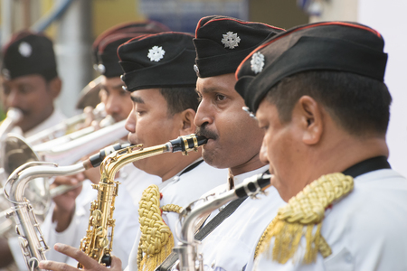 west bengal: KOLKATA, WEST BENGAL , INDIA - JANUARY 17TH 2016 : Kolkata Police Force Officers, dressed in white and black suits, are playing band, using various musical instruments, in a winter morning.