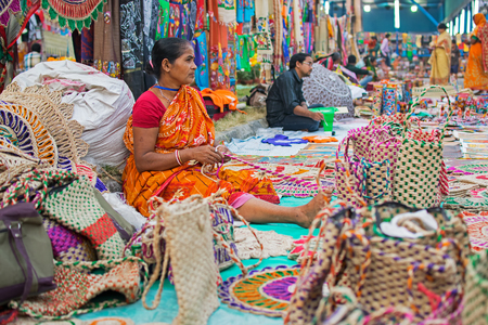 weaved: Kolkata, West Bengal, India - 28th November, 2015 : Woman hand weaving jute bags, handicrafts on display during the Handicraft Fair in Kolkata. Biggest handicrafts fair in Asia.