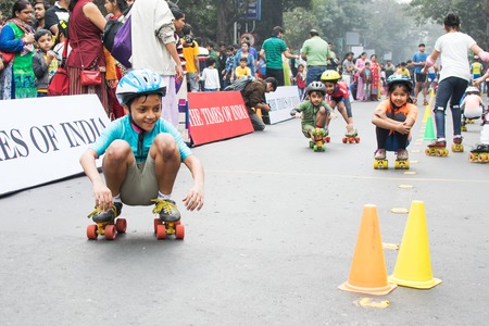 roller blade: KOLKATA, WEST BENGAL, INDIA - JANUARY 17TH 2016 : Unidentified city children rollerskating on blocked, otherwise busy,Park Street for Happy Street event. Children played, enjoyed and had fun. Editorial