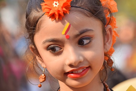 make known: KOLKATA , INDIA - MARCH 12, 2017: Young girl with spring festive make up with flowers , joyful expression at HoliSpring festival,known as Dol (in Bengali) or Holi (in Hindi) celebrating arrival of Spring in India. Editorial