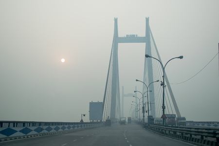 Second Hoogly Bridge, also called Vidyasagar Setu, connects Kolkata and Howrah - two major cities of West Bengal. It is the longest cable-stayed bridge in India. Shot at winter dawn. Stock Photo