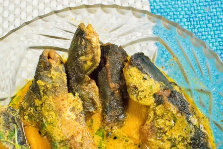 Tyangra fish , scientific name - Batasio batasio or Mystus tengara or Macrones vittalus, cooked and served in plate. These are very popular fishes in West Bengal (India) and Bangladesh. Bengalis love to eat them.