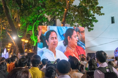 tagore: KOLKATA, WEST BENGAL , INDIA - 9TH MAY 2017 : Chief Minister of West Bengal, Ms. Mamata Banerjee, smiling to the audience from screen at Rabindra Jayanti celebration (birthday of Late Poet Rabindranath Tagore). Editorial