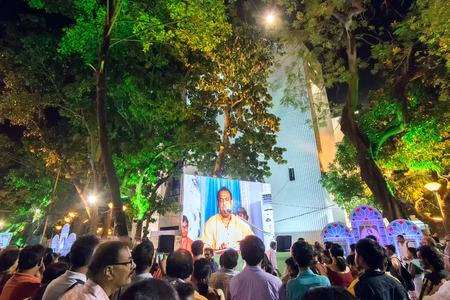 tagore: KOLKATA, WEST BENGAL , INDIA - 9TH MAY 2017 : Male singer performing and seen in a giant screen amongst audience , at Rabindra Jayanti celebration (birthday of Late Nobel winner Poet Rabindranath Tagore). Editorial