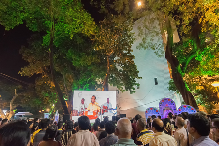 KOLKATA, WEST BENGAL , INDIA - 9TH MAY 2017 : Male singer performing and seen in a giant screen amongst audience , at Rabindra Jayanti celebration (birthday of Late Nobel winner Poet Rabindranath Tagore). Editorial