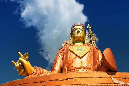 Samdruptse statue , a huge buddhist memorial statue in Sikkim, blue cloudy sky in background. It is a fourite tourist spot in Sikkim. Stock Photo