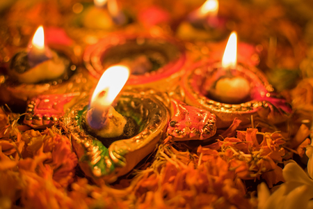 Deepabali , Deepavali or Deepawali - the festival of lights, is widely celebrated in India and now all over the world. Rangoli Diyas - colourful and decorated candles are lit in night to throw away darkness, on this auspicious occassion. Stock Photo - 80228520