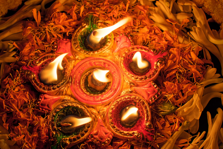 Deepabali , Deepavali or Deepawali - the festival of lights, is widely celebrated in India and now all over the world. Rangoli Diyas - colourful and decorated candles are lit in night to throw away darkness, on this auspicious occassion.