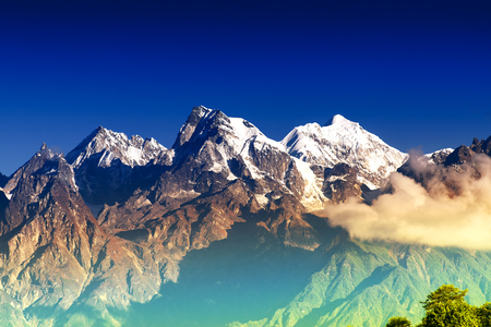 From left - Mount South Kabru (24215 feet), Mount North Kabru and Mount Talung (24200 feet) - beautiful view of great Himalayan mountains at Ravangla, Sikkim.