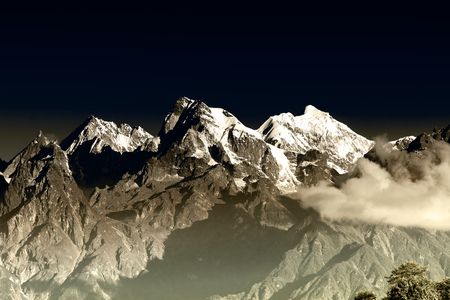 From left - Mount South Kabru (24215 feet), Mount North Kabru and Mount Talung (24200 feet) - beautiful view of great Himalayan mountains at Ravangla, Sikkim. Tinted image.