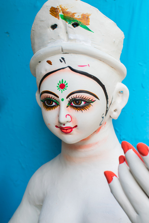 KOLKATA, WEST BENGAL, INDIA - 25 SEPTEMBER 2016: Clay idol of Goddess Durga's face, under preparation for