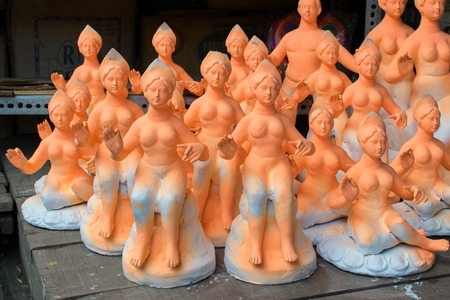 KOLKATA, WEST BENGAL, INDIA - 25 SEPTEMBER 2016: Clay idols of Goddess Saraswati , goddess of knowledge, under prepartion for Saraswati Puja (worship) festival in Kumartuli, Kolkata. Stock Photo