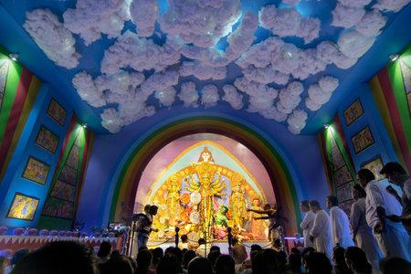 devotee: KOLKATA , INDIA - OCTOBER 9, 2016 : Priest praying to Goddess Durga, Durga Puja festival celebration. Biggest religious festival of Hinduism and Kolkatas Bengali Community. Documentary editorial.