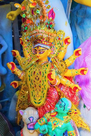 KOLKATA, WEST BENGAL, INDIA - 25 SEPTEMBER 2016: Clay idol of Goddess Durga, under preparation for Durga Puja festival in Kumartuli, Kolkata. Biggest festival of Hinduism.