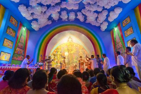 gods: KOLKATA , INDIA - OCTOBER 9, 2016 : Priest praying to Goddess Durga, Durga Puja festival celebration. Biggest religious festival of Hinduism and Kolkatas Bengali Community. Documentary editorial.