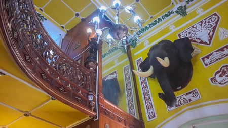 karnataka: BENGALURU, INDIA - FEBRUARY 20, 2017: Interior decoration of famous Bangalore Palace. It was private residence of the royal Wodeyar family. It is filled with rare collection of art and paraphernalia from a bygone era. Editorial