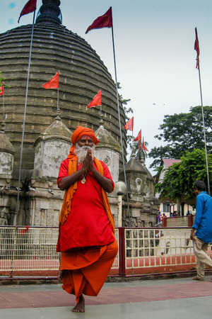 GUWAHATI, ASSAM, INDIA - JULY 4, 2014 : Hindu Sadhu standing by one bare foot for hours , at famous Kamakhya Temple or Kamrup-Kamakhya temple, dedicated to mother goddess Kamakhya.