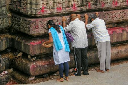 GUWAHATI, ASSAM, INDIA - JULY 4, 2014 : Hindu devotees worshiiping at Kamakhya Temple or Kamrup-Kamakhya temple, dedicated to the mother goddess Kamakhya. Sajtókép