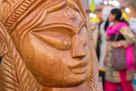 Wood made Goddess Durga, handicrafts on display during the Handicraft Fair in Kolkata - the biggest handicrafts fair in Asia.