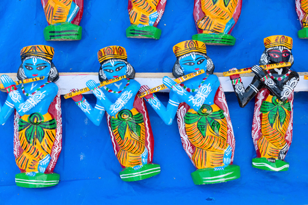 Wood made idols of Lord Krishna, handicrafts on display during the Handicraft Fair in Kolkata , earlier Calcutta, West Bengal, India. It is the biggest handicrafts fair in Asia.