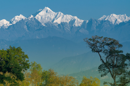 Beautiful view of Silerygaon Village with Kanchenjunga mountain range at the background, moring light, at Sikkim, India Stock Photo