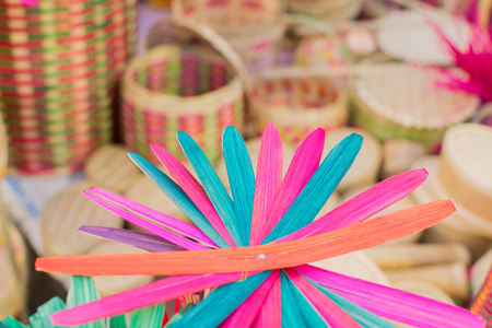 Cane made artificial colored flowers, handicrafts on display in Handicraft Fair in Kolkata - the biggest handicrafts fair in Asia. Stock Photo