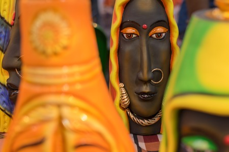 Face of tribal woman, colorful dolls made of clay, handicrafts on display during the Handicraft Fair in Kolkata , earlier Calcutta, West Bengal, India. It is the biggest handicrafts fair in Asia.