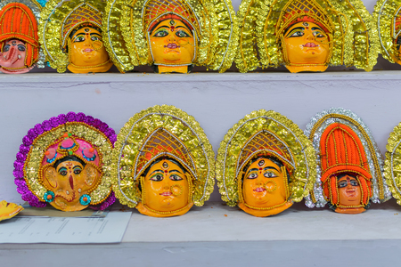 Colored masks of Chhacu dancers, colorful dolls made of clay, handicrafts on display during the Handicraft Fair in Kolkata , earlier Calcutta, West Bengal, India. Stock Photo