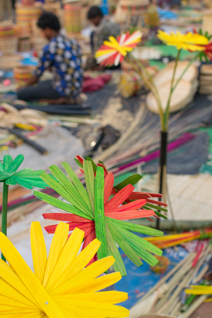 cane made artificial colored flowers, handicrafts on display in Handicraft Fair in Kolkata - the biggest handicrafts fair in Asia.